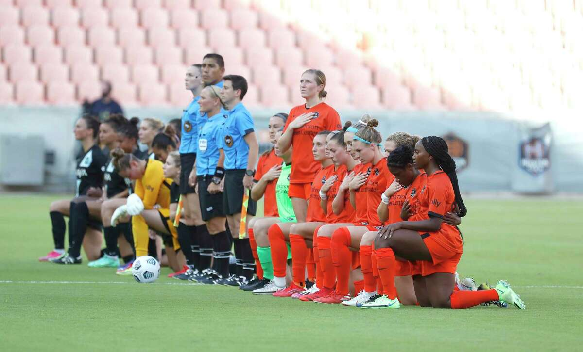 Houston Dash and NJ/NY Gotham FC during the National Anthem during the first half of a National Womens Soccer League game at BBVA Stadium, Sunday, August 1, 2021, in Houston.