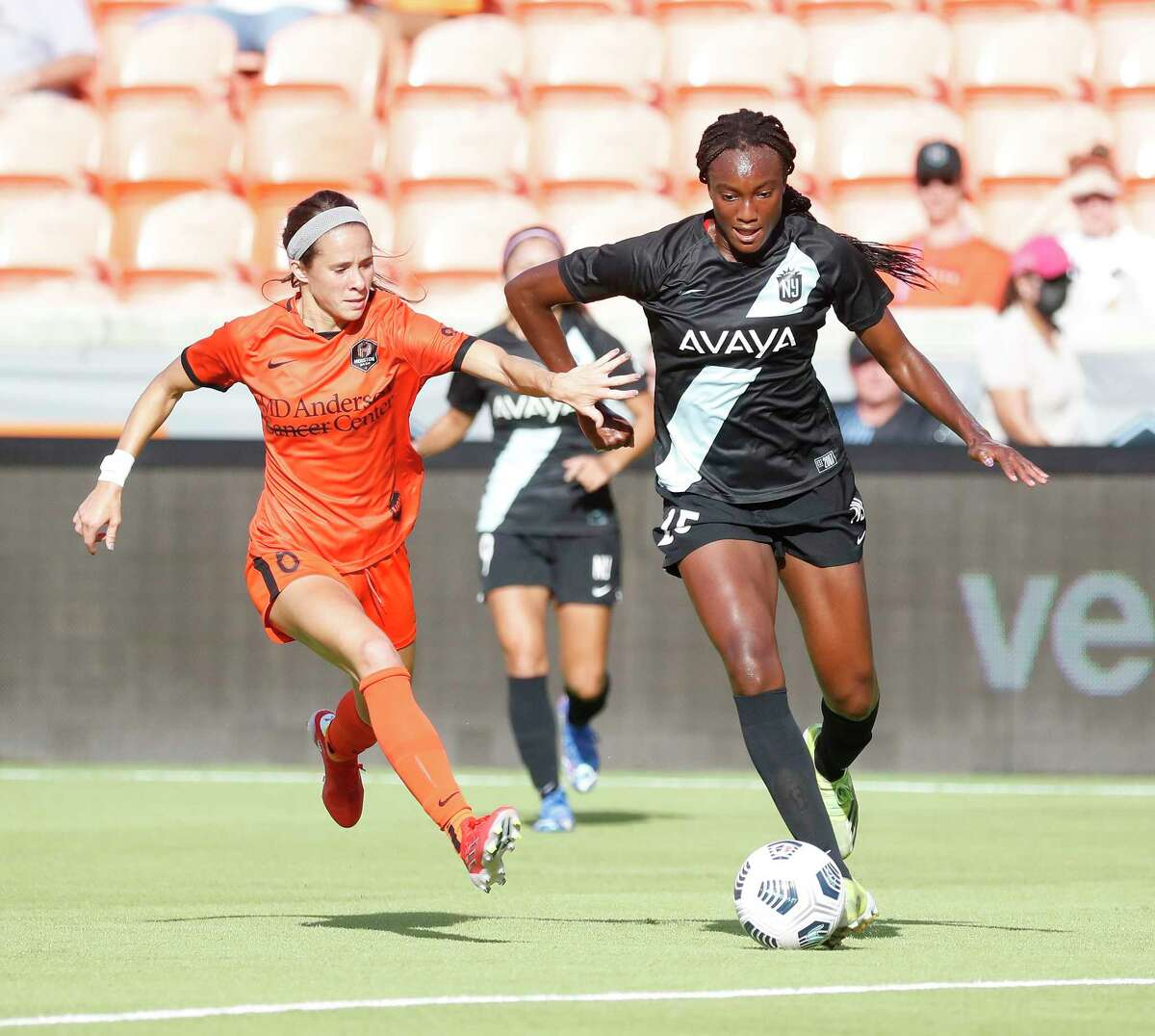 Houston Dash midfielder Shea Groom (6) chases NJ/NY Gotham FC forward Ifeoma Onumonu (25) during the first half of a National Womens Soccer League game at BBVA Stadium, Sunday, August 1, 2021, in Houston.