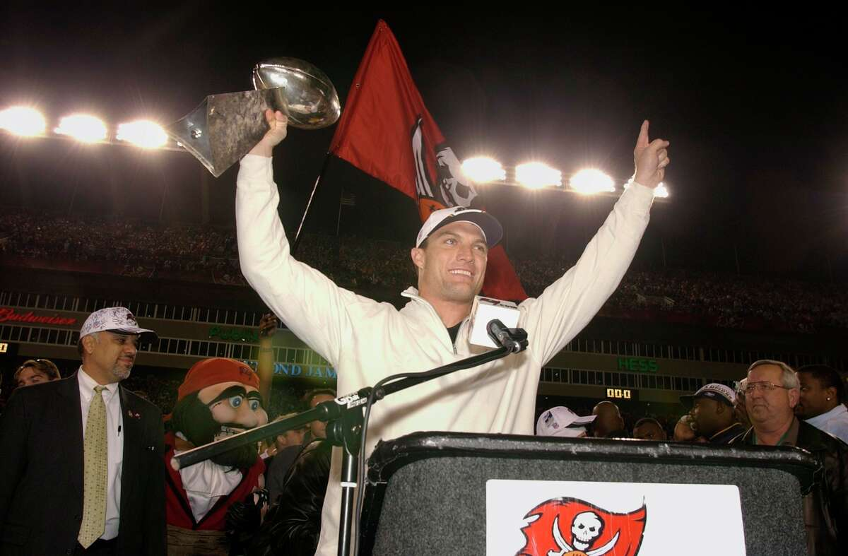 FILE - In this Jan. 27, 2003, file photo, Tampa Bay Buccaneers' John Lynch holds the Vince Lombardi Trophy during a victory celebration at Raymond James Stadium in Tampa, Fla. Lynch earned his first of nine Pro Bowl selections in his second season as a full-time starter in 1997, was named an All-Pro in back-to-back seasons in 1999 and 2000 and then played a big part in Tampa's first Super Bowl title in the 2002 season. Lynch will be inducted into the Pro Football Hall of Fame on Aug. 8, 2021. (AP Photo/Scott Martin, File)