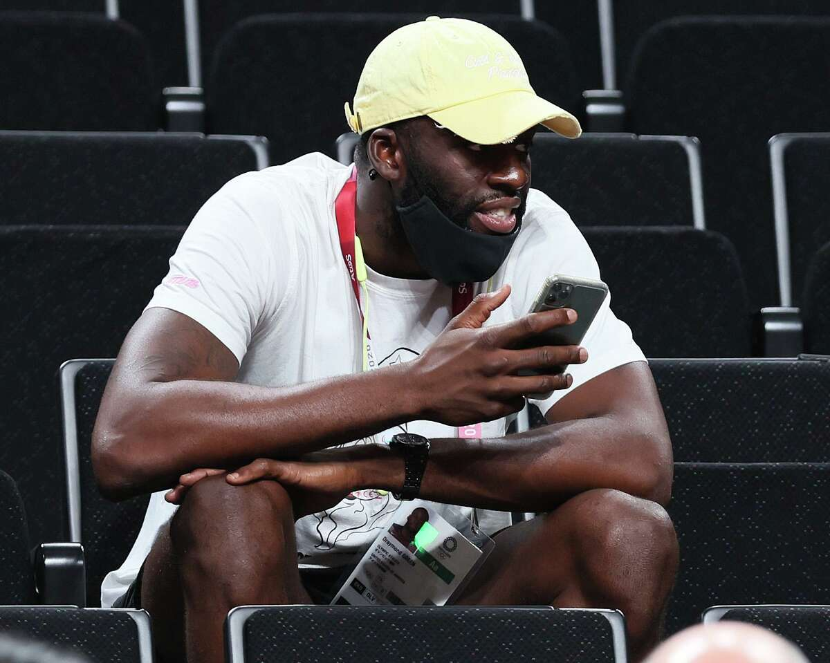SAITAMA, JAPAN - AUGUST 02: Draymond Green looks on during the first half of a Women's Basketball Preliminary Round Group B game between France and United States of America on day ten of the Tokyo 2020 Olympic Games at Saitama Super Arena on August 02, 2021 in Saitama, Japan. (Photo by Mike Ehrmann/Getty Images)