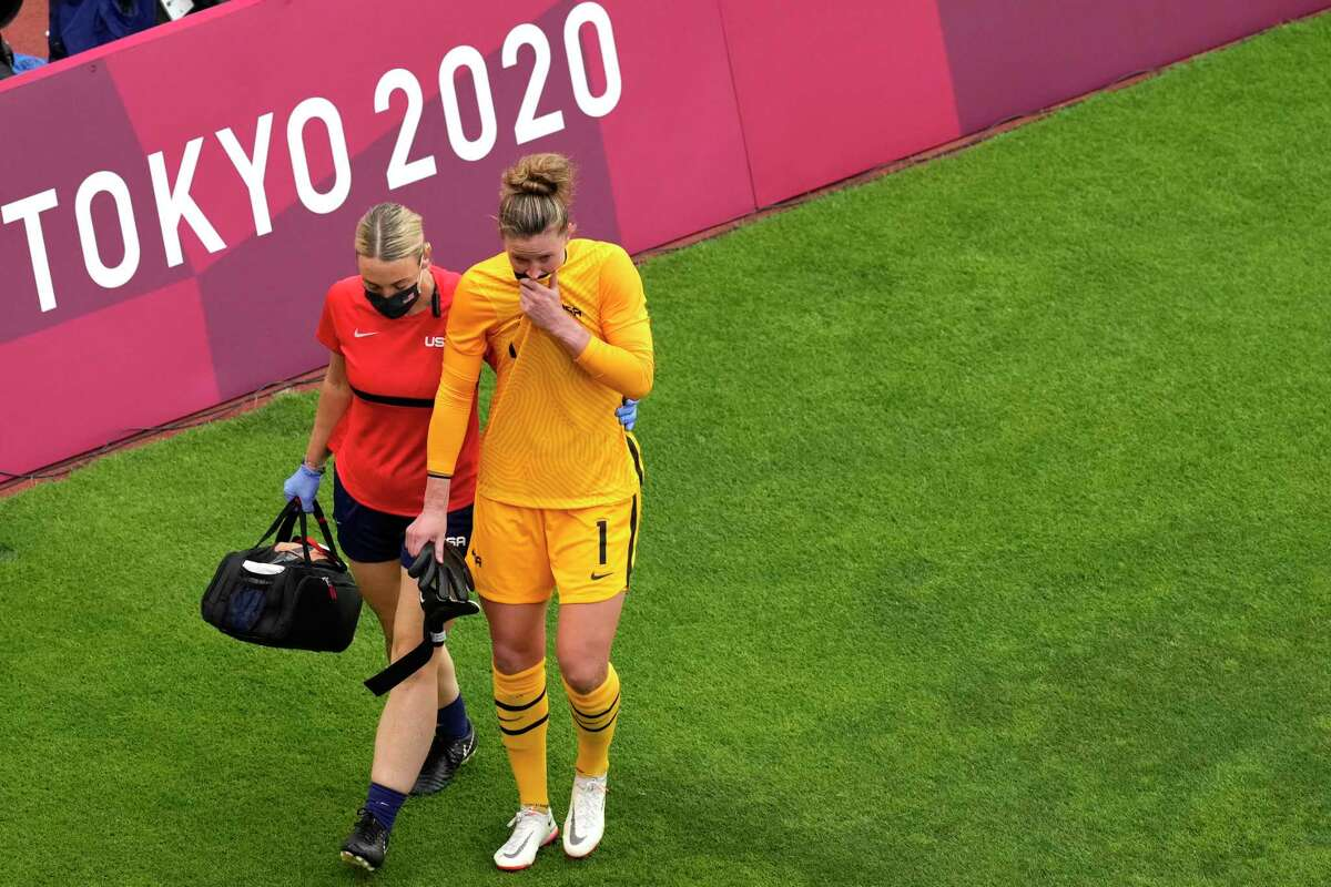 United States' goalkeeper Alyssa Naeher leaves the field after being injured during a women's semifinal soccer match against Canada at the 2020 Summer Olympics, Monday, Aug. 2, 2021, in Kashima, Japan. (AP Photo/Martin Mejia)