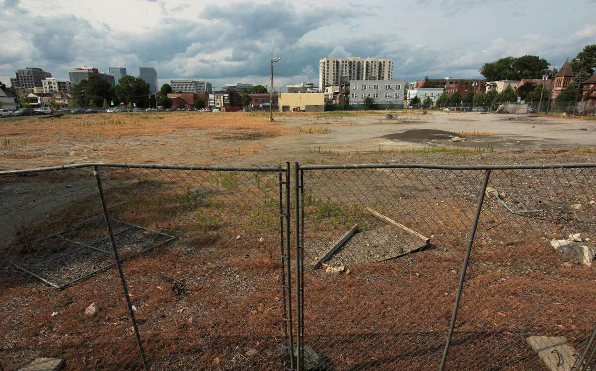 A view of the former B&S Carting site between Walter Wheeler Drive and Woodlawn Avenue in Stamford, Conn., on Thursday July 22, 2021. Developer Building and Land Technology wants to put more apartments on, but residents have fought tooth and nail to discourage the development.