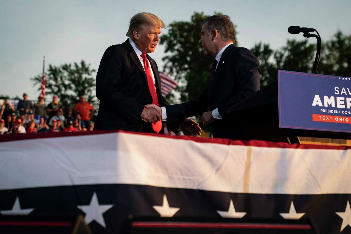 Former president Donald Trump speaks with Republican congressional candidate Mike Carey at a rally at the Lorain County Fairgrounds on June 26 in Wellington, Ohio.