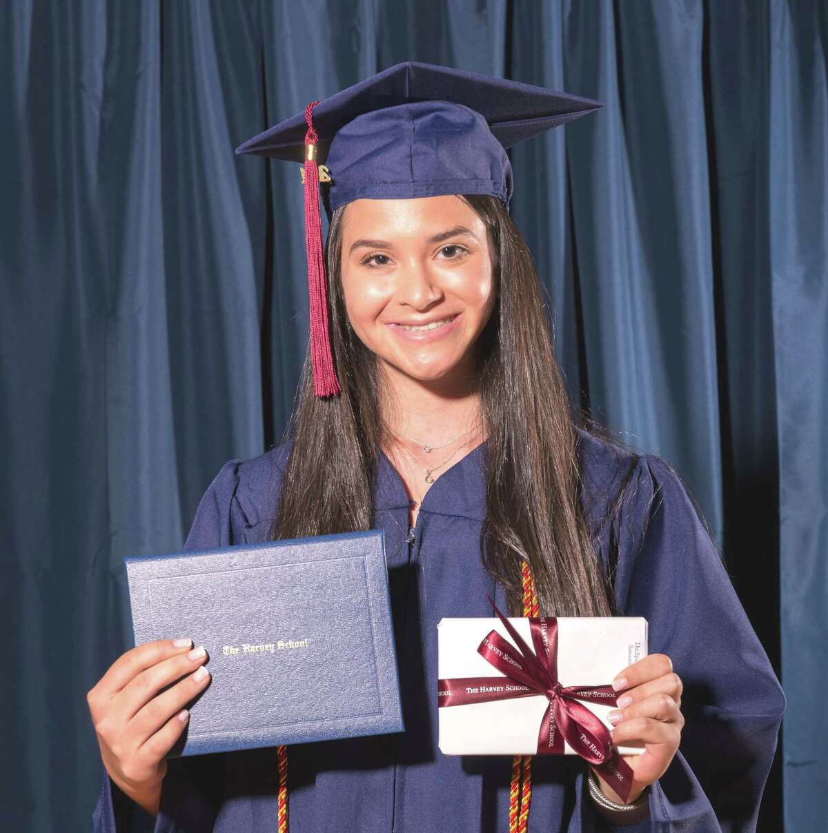Samantha Fern of Greenwich with her diploma and Spanish Prize at The Harvey School 2021 commencement June 10.
