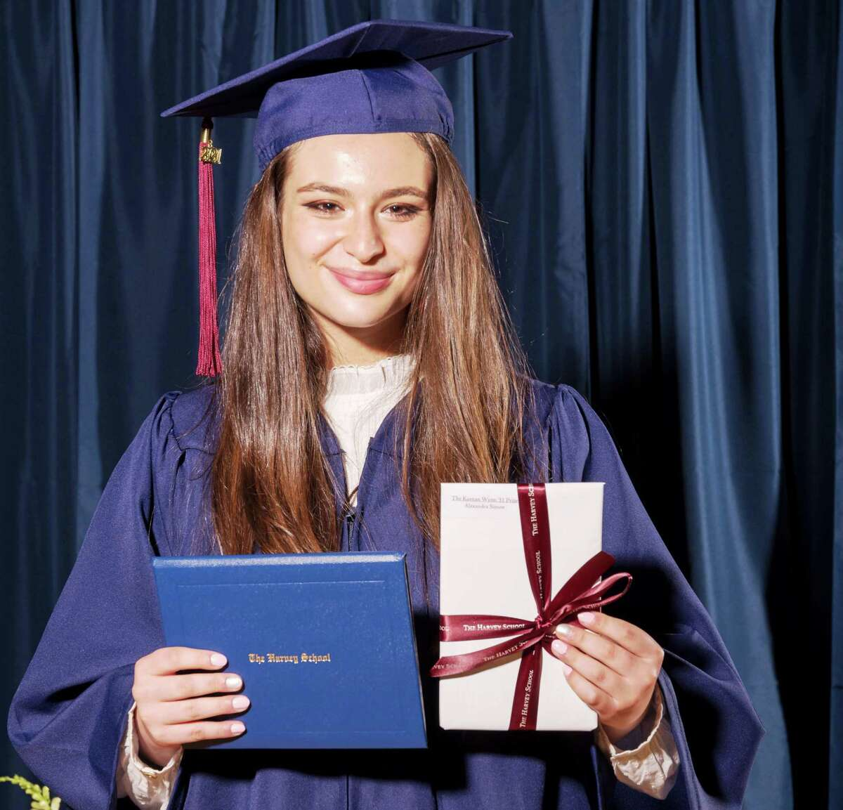 Alexandra Simon of Greenwich with diploma and drama award in hand at her Harvey School commencement June 10.