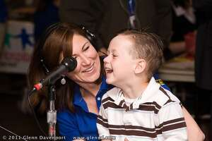 Kelly Lynch with her son at an early radiothon.