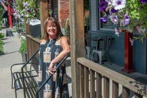 Owner Patty Novo stands outside Taverna Novo on Wednesday, July 28, 2021 in Saratoga Springs, N.Y.