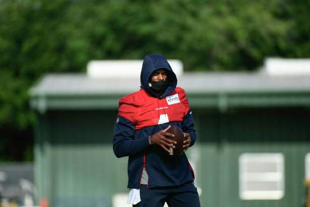 Texans quarterback Deshaun Watson (4) works out with the team during NFL football practice Saturday, July 31, 2021, in Houston. (AP Photo/Justin Rex)
