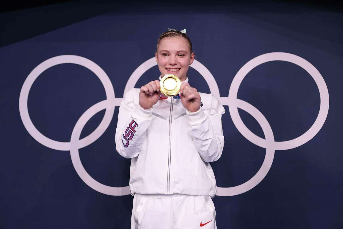 Jade Carey shows off her gold medal from the floor exercise.