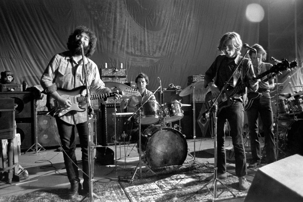 """Music group The Grateful Dead with Ron """"Pigpen"""" McKernan (1945-1973) on keyboards, Jerry Garcia (1942-1995), Bill Kreutzmann on drums, Phil Lesh and Bob Weir perform on stage during """"A Night at the Family Dog by the Bay"""" on February 4, 1970 in San Franicsco, California."""
