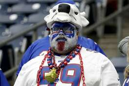 A Buffalo Bills fan looks on during warm ups before the AFC Wild Card Playoff game against the Houston Texans at NRG Stadium on January 04, 2020 in Houston, Texas. (Photo by Bob Levey/Getty Images)