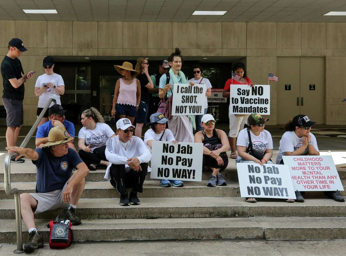People gathered outside Houston Methodist to protest the hospital's mandate that all staff must be vaccinated against COVID-19 or be terminated, on Saturday, June 26, 2021, in Houston.