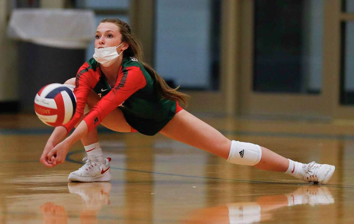 The Woodlands defensive specialist Molly Tuozzo (3) returns a serve during the second set of a non-district high school volleyball match at Klein High School, Saturday, Oct. 10, 2020, in Spring.