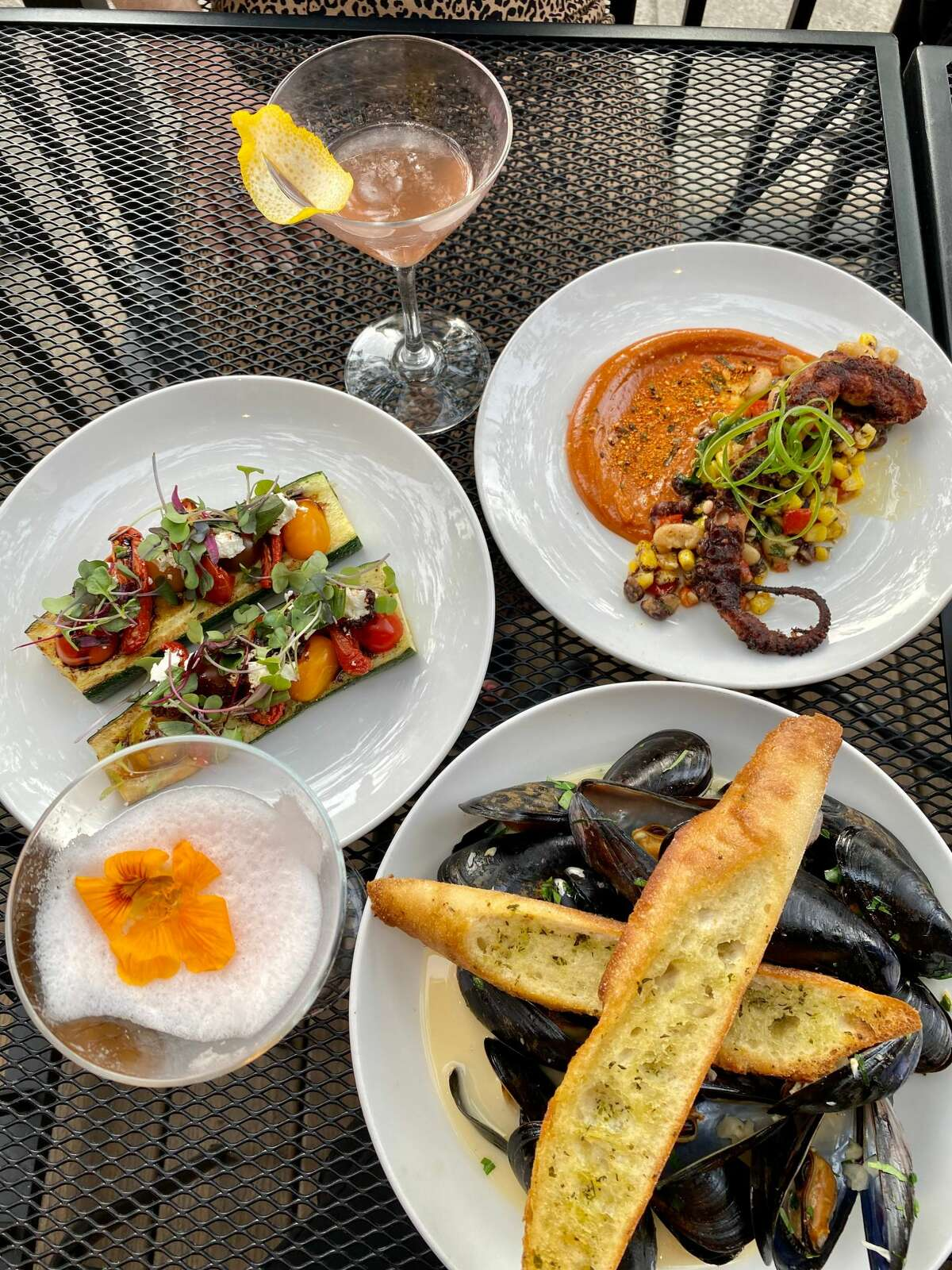 Starters at The Merc in Saratoga Springs including, clockwise from left, stuffed zucchini, octopus with Asian spices and mussels in a wine-garlic sauce. (Susie Davidson Powell/for the Times Union)