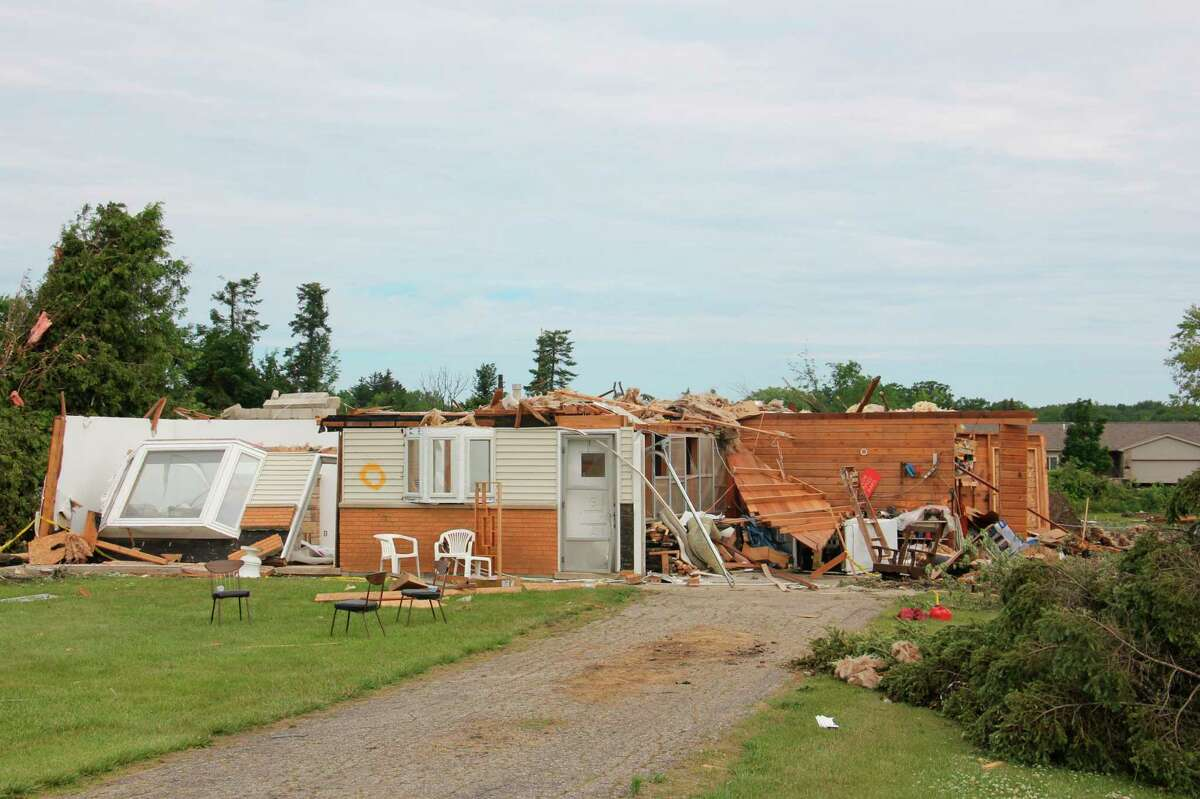 John and Sheri Kress' second home on Grindstone Road near Independence Avenue was destroyed by the June 26 tornado. This photo was taken two days after the tornado before volunteers' clean-up efforts began on Grindstone. (Teresa Homsi/Huron Daily Tribune)