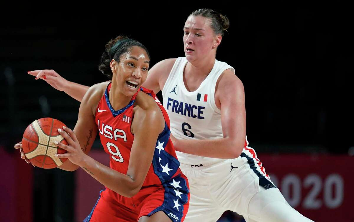 United States' A'Ja Wilson (9) drives around France's Alexia Chartereau (6) during women's basketball preliminary round game at the 2020 Summer Olympics, Monday, Aug. 2, 2021, in Saitama, Japan. (AP Photo/Charlie Neibergall)