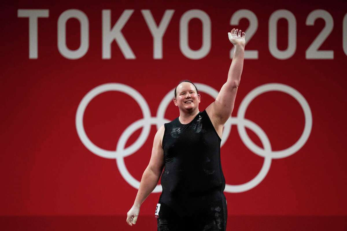 Laurel Hubbard of New Zealand waves after a failed lift in women's +87kg weightlifting at Tokyo International Forum during the postponed 2020 Tokyo Olympics in Tokyo on Aug. 2, 2021. Laurel Hubbard became the first openly transgender woman to participate in the Olympics. (Doug Mills/The New York Times)