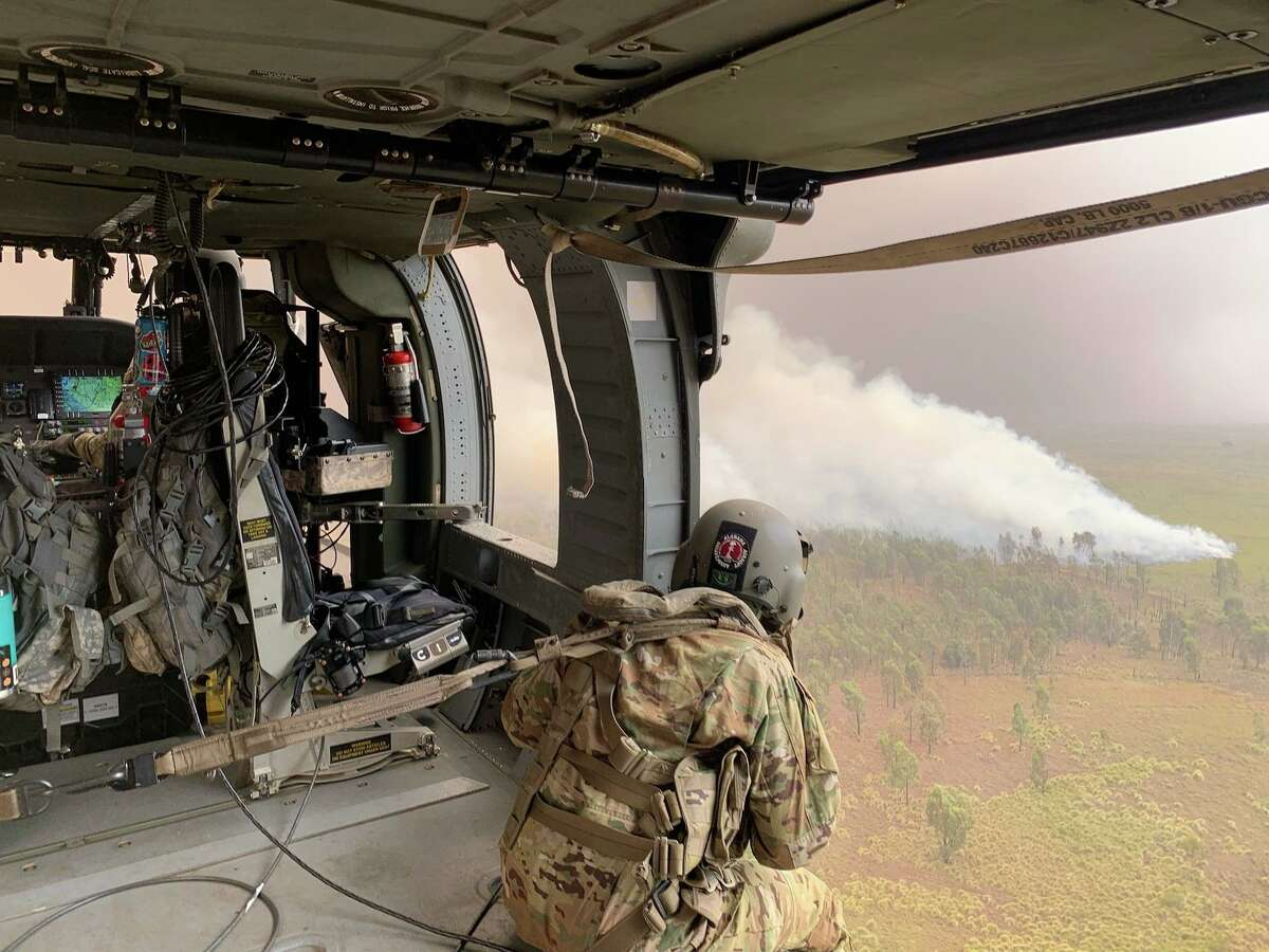 Members of the 25th Combat Aviation Brigade responding to a large brush fire on Hawaii's Big Island.