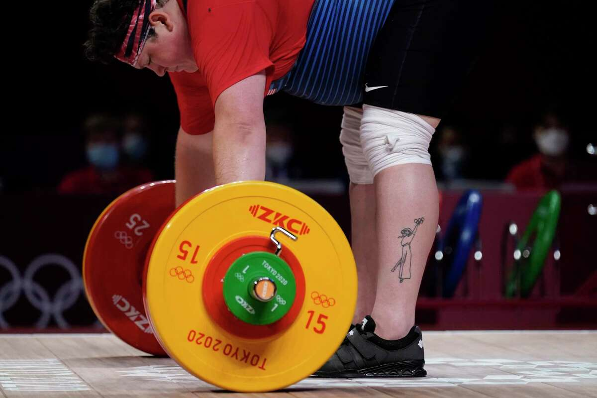 Sarah Robles, who trains in Houston, prepares to lift, in the women's +87kg weightlifting event at the 2020 Summer Olympics,