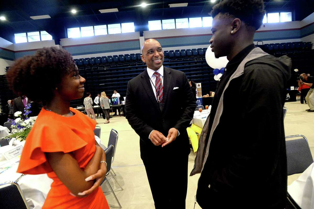 Superintendent Mark Porterie talks with Memorial high students Alanna Lewis and Carlton Antoine while gathering for a Port Arthur ISD State of Education meeting and luncheon held at Lamar State College Port Arthur Tuesday. Students, educators, representatives from PAISD and LSCPA, local businesses and elected officials came together for the event. Photo taken Tuesday, February 11, 2020 Kim Brent/The Enterprise