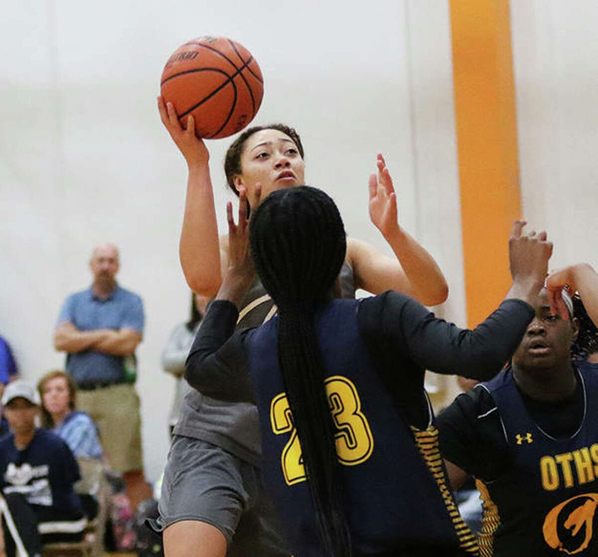 Marquette's Alyssa Powell puts up a shot against O'Fallon in a summer game at Edwardsville. Powell, who earned All-MVC honors playing for Triad last season, has transferred to Marquette for her senior year.