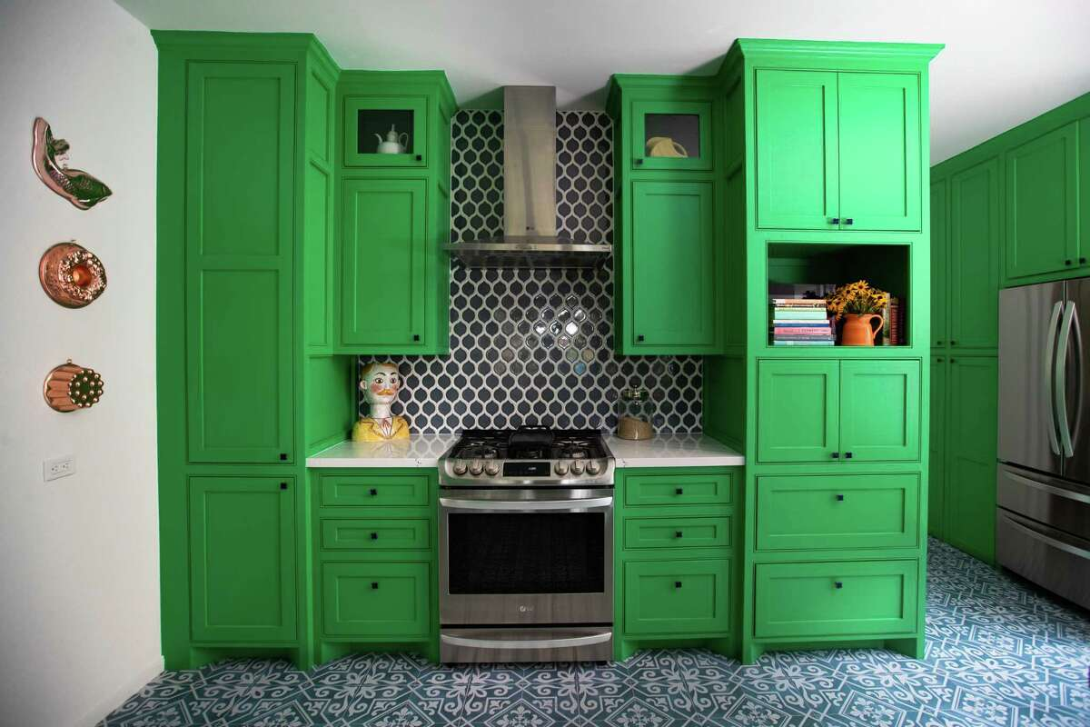 Ilse Benard used Benjamin Moore's Kelly Green paint on her kitchen cabinets. Burst pipes during Winter Storm Uri prompted her to remodel her kitchen.
