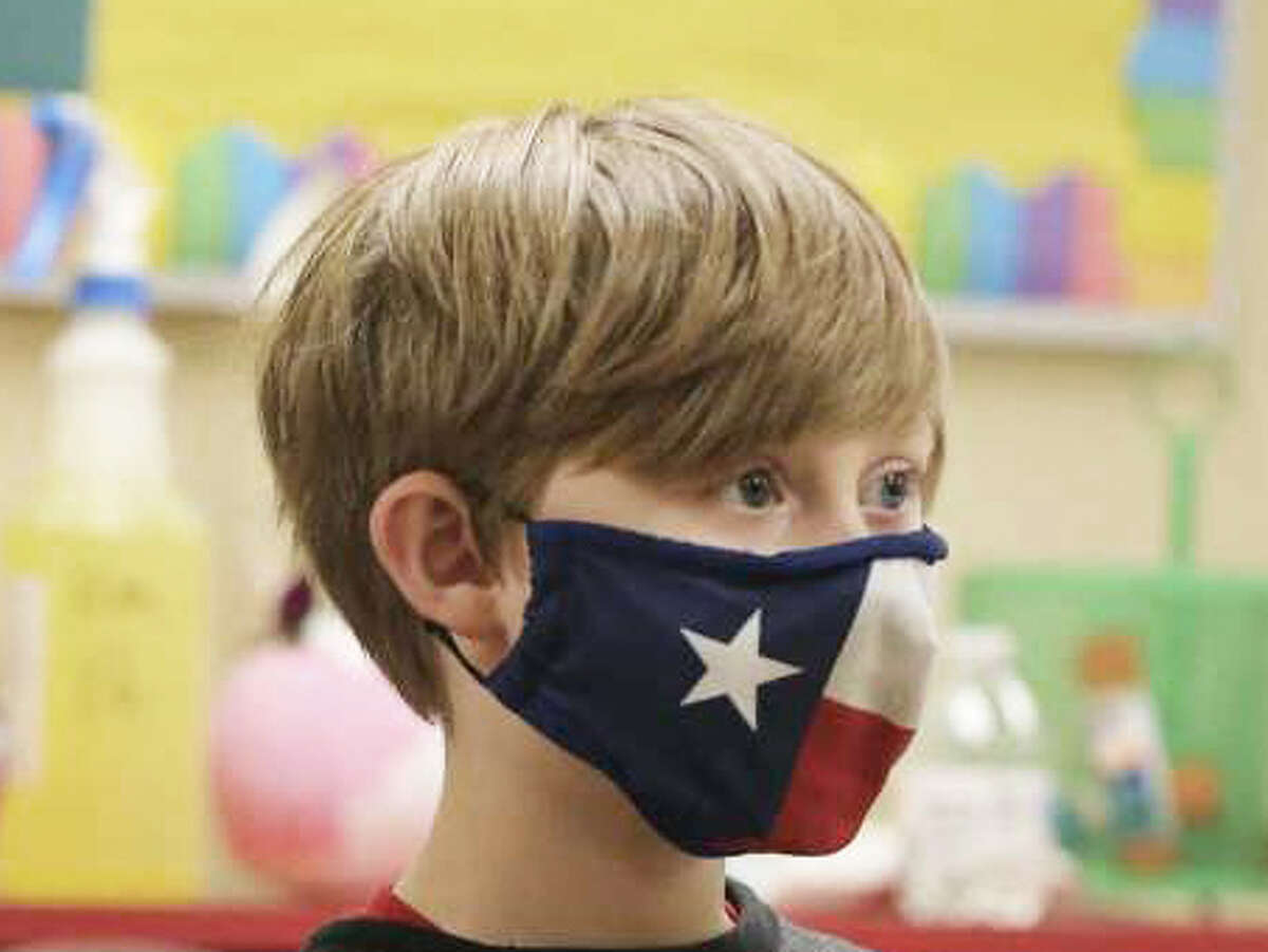 Then-third-grader Logan Sapp wears a Texas flag-inspired mask in class on Thursday, Dec. 3, 2020. Sapp was among Students at Pearce Elementary at Southside ISD who attended a combination of online and in-person class learning. North East Independent School District on Thursday announce a return to virtual learning for immunocompromisedstudents.