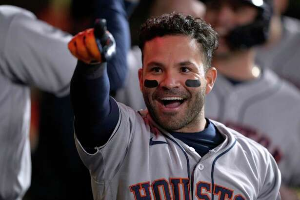 Houston Astros' Jose Altuve points to fans after hitting a grand slam against the San Francisco Giants during the sixth inning of a baseball game Friday, July 30, 2021, in San Francisco. (AP Photo/Tony Avelar)