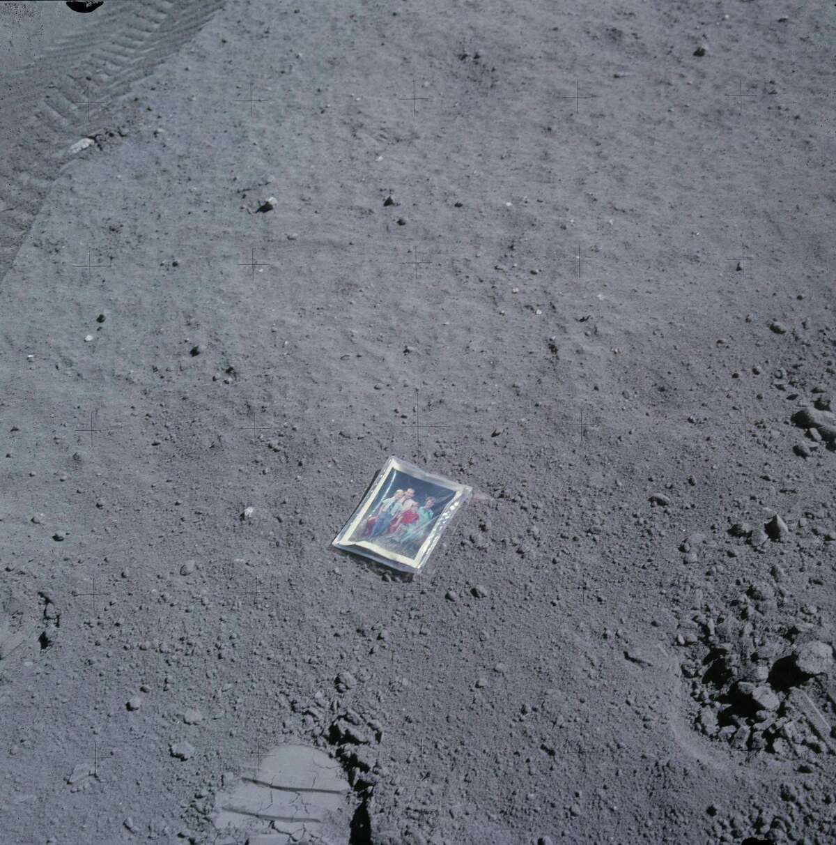 As lunar module pilot during the Apollo 16 mission in 1972, Charles Duke left a plastic encased photo of him and his family -- wife Dorothy and sons Charles III, 7 at the time, and Thomas, 5 -- on the moon's surface.
