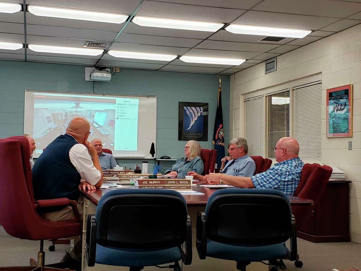 The Huron County Commissioners talk before last week's meeting, where they made adjustments to the county expo center's rental rates. (Robert Creenan/Huron Daily Tribune)