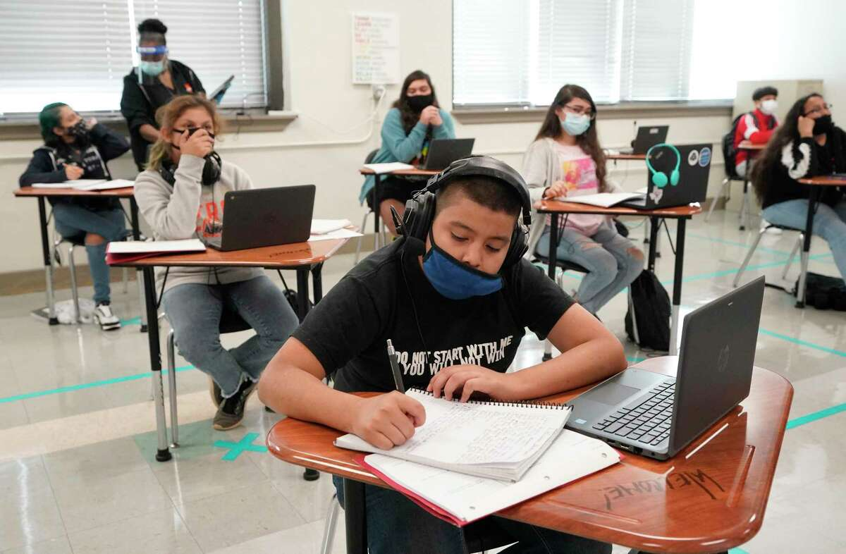 Students work during an eighth grade reading class at Yolanda Black Navarro Middle School on Oct. 19 in Houston.