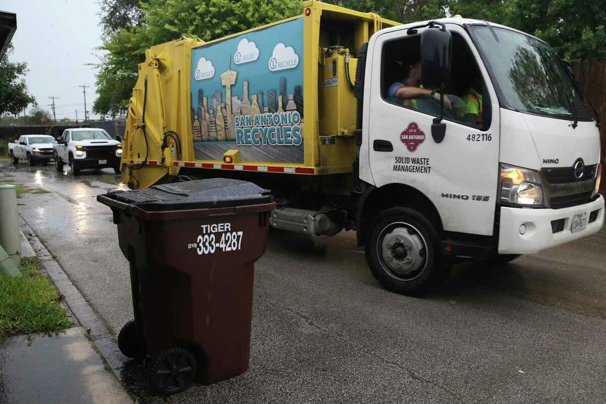 City of San Antonio Solid Waste Management picks up trash for the last time in the Camelot II subdivision in Bexar County on Monday. Bexar County contracted with Tiger Sanitation for trash pickup in Camelot and surrounding neighborhoods.