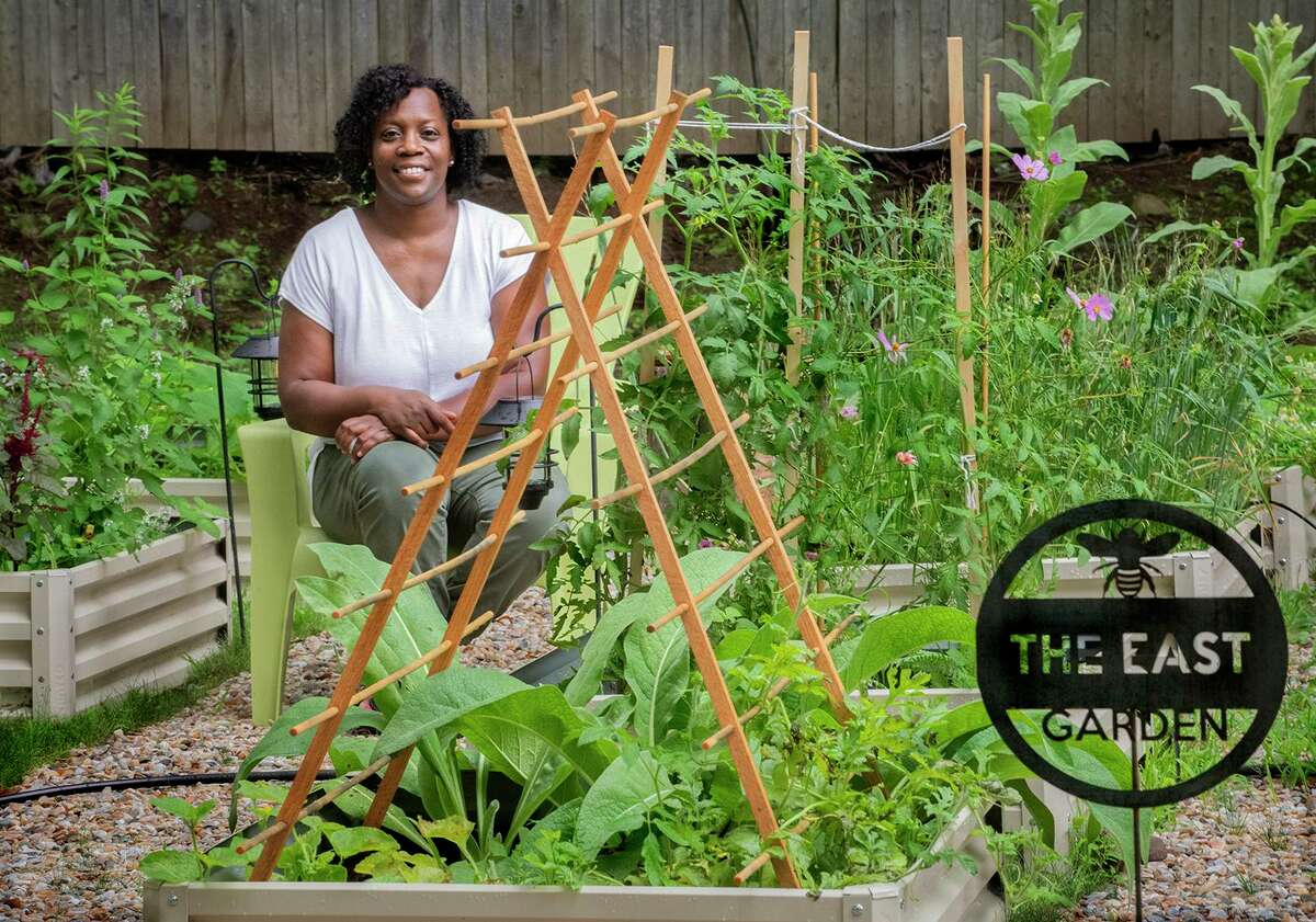 Tammy R. Chapman in her garden. In addition to vegetables she grows medicinal herbs and plants to attract pollinators.