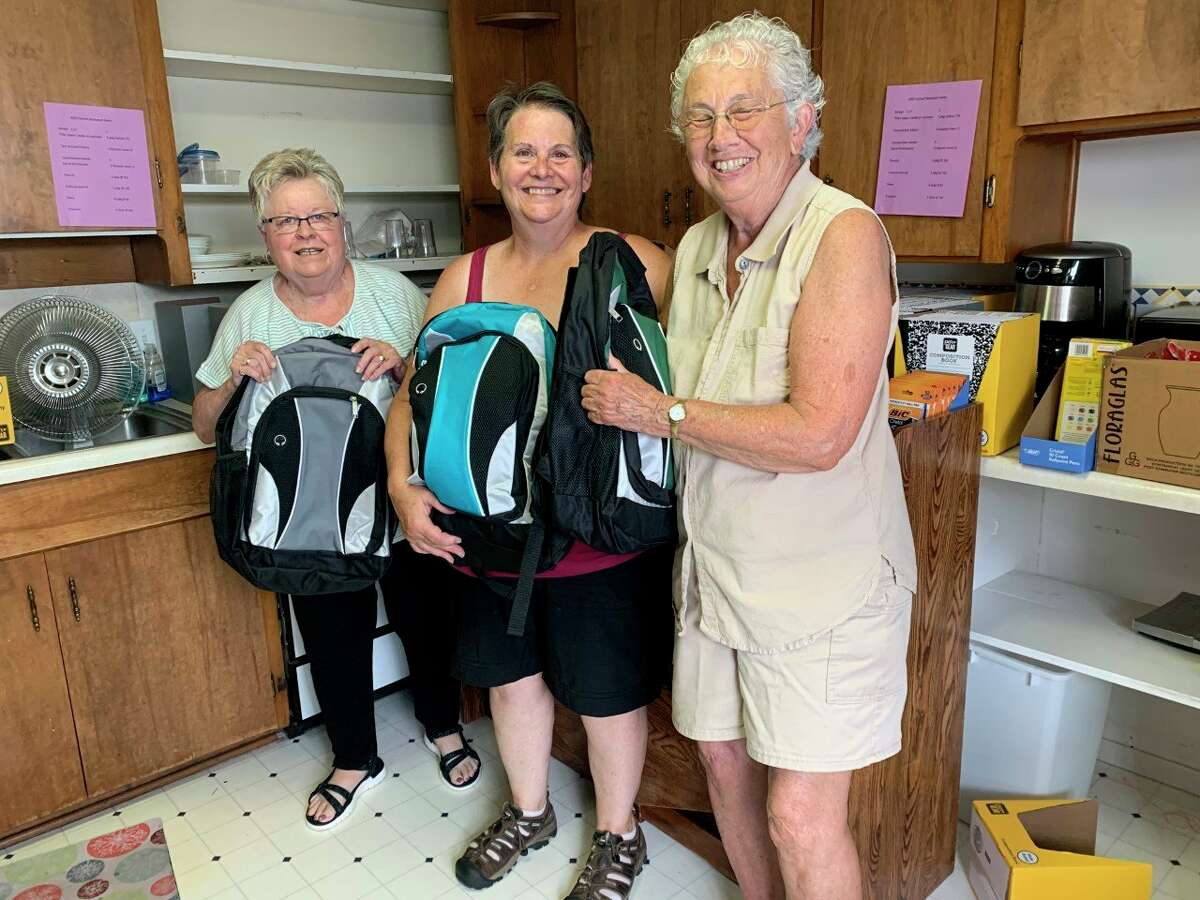 Manna Pantry volunteers prepare backpacks for students in gradesfifth through 12thas part of the annual school backpack program. (Submitted photo)