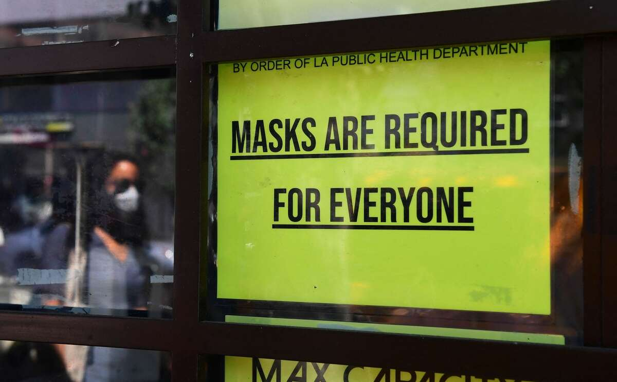 A storefront sign reminds people masks are for everyone on July 19, 2021, in Los Angeles.