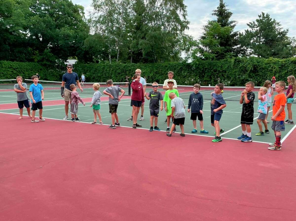 Kids and volunteers get ready for activities at the tennis courts at Port Austin Village Park. (Port Austin Summer Parks and Rec/Courtesy Photo)