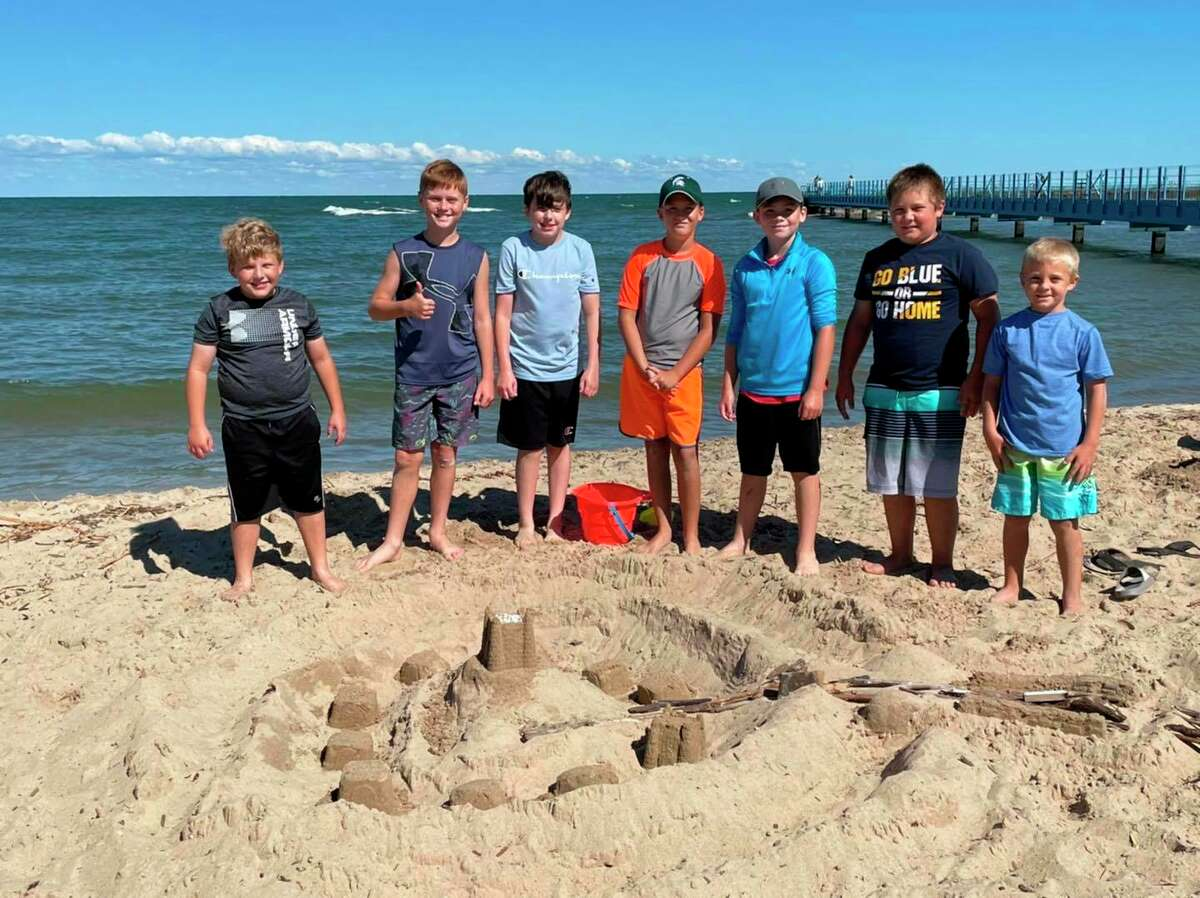 Participants in this year's Port Austin's Summer Parks and Recreation program build sand castles on the village beach. Program organizers had no trouble finding volunteers or kids that wanted to sign up this year. (Port Austin Summer Parks and Rec/Courtesy Photo)