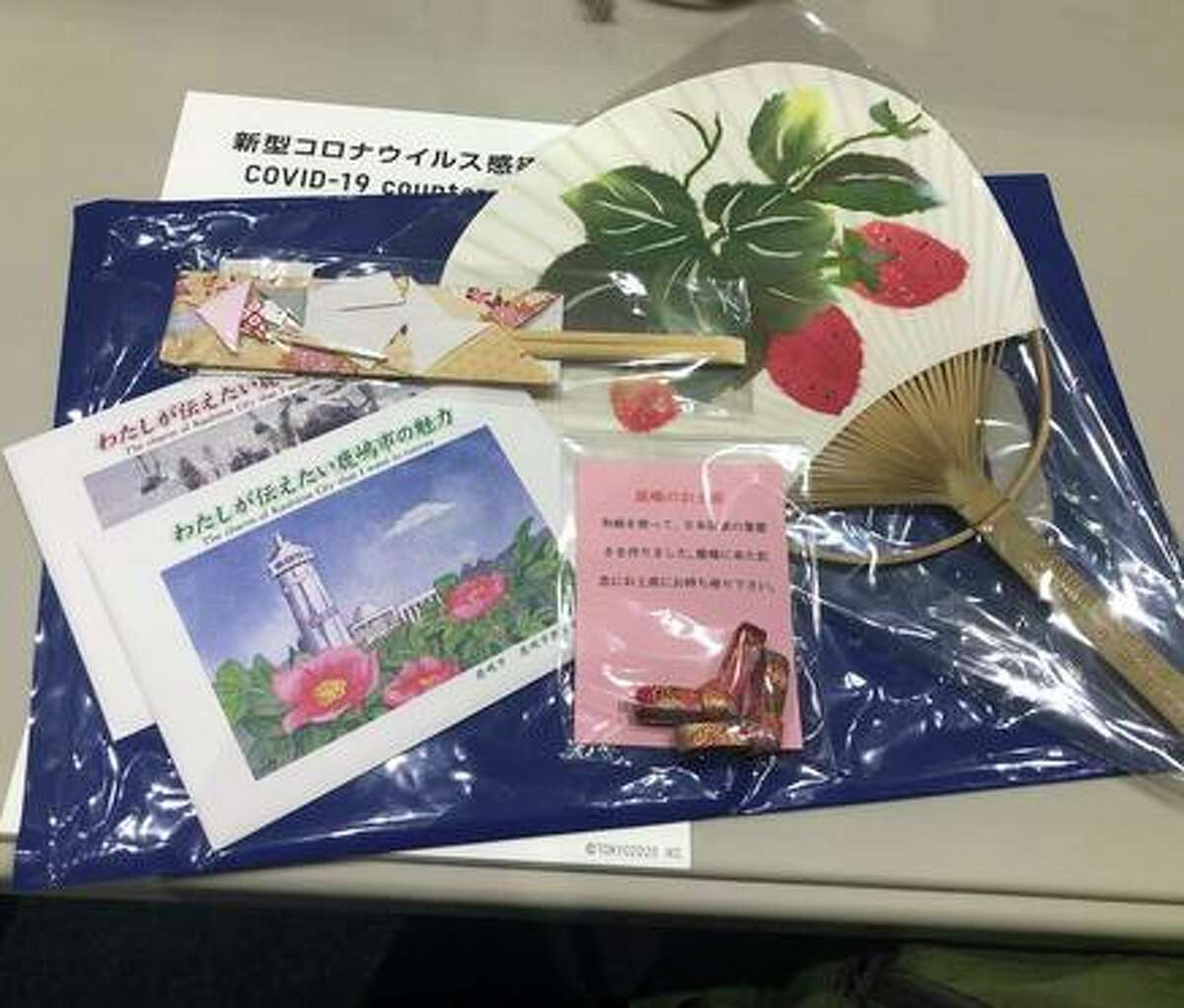 Contents of the media gift bag at Kashima Stadium.