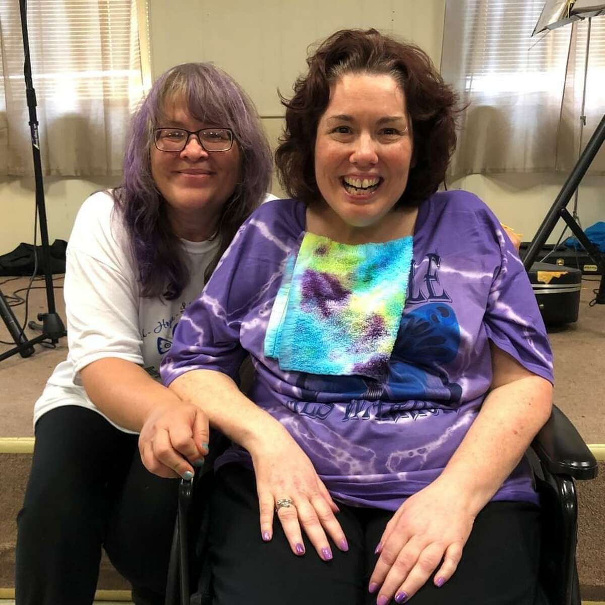 A fundraiser to buy a new van for Richelle Roman Lovato of Torrington, who has ALS, was held July 30 at the Eagle Club. Lovato, right, is pictured with childhood friend Virginia Cianciolo, who organized the event.