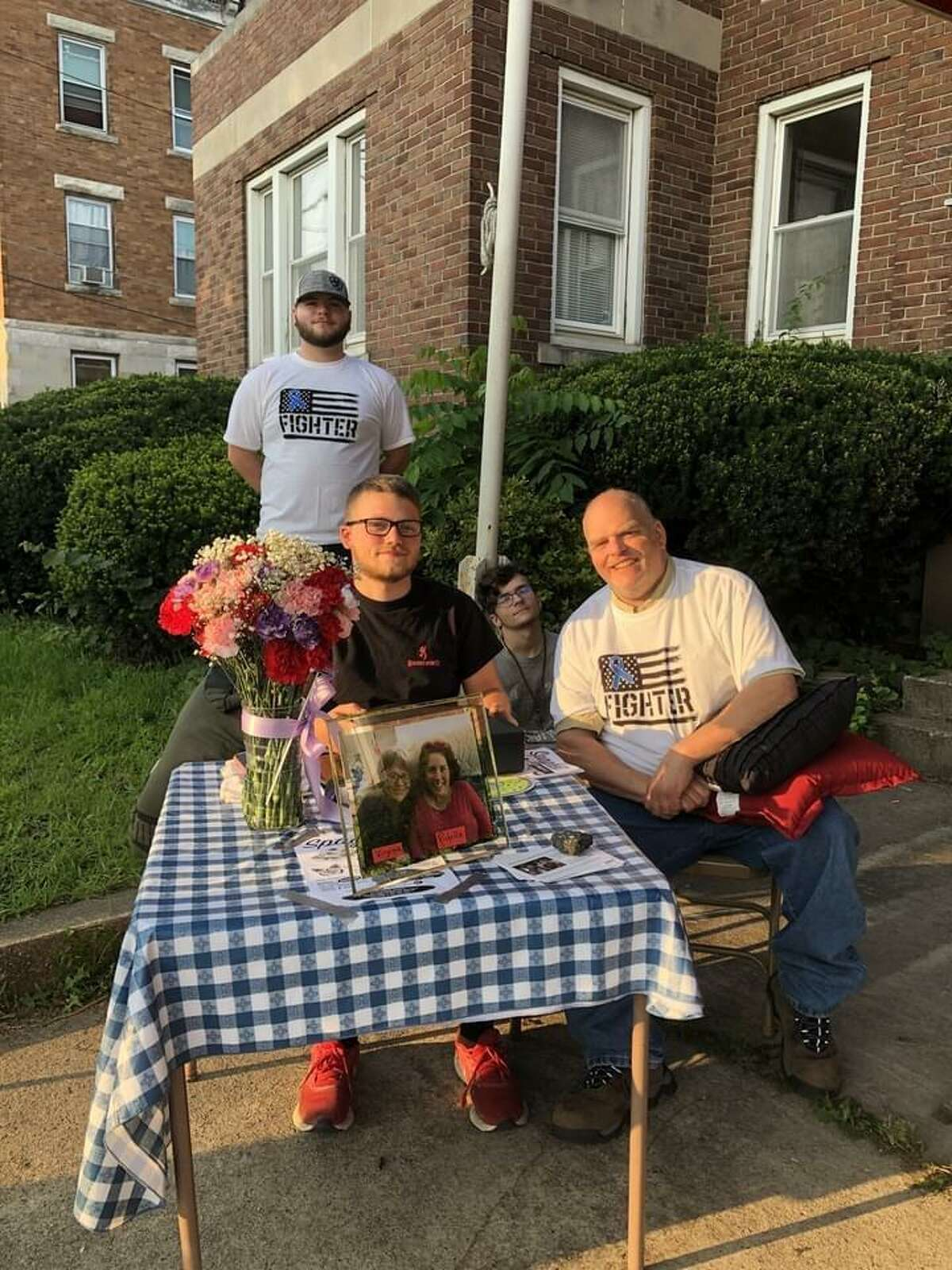 A fundraiser to buy a new van for Richelle Roman Lovato of Torrington, who has ALS, was held July 30 at the Eagle Club. Volunteers collect money at the door of the Eagles Club for the spaghetti dinner.