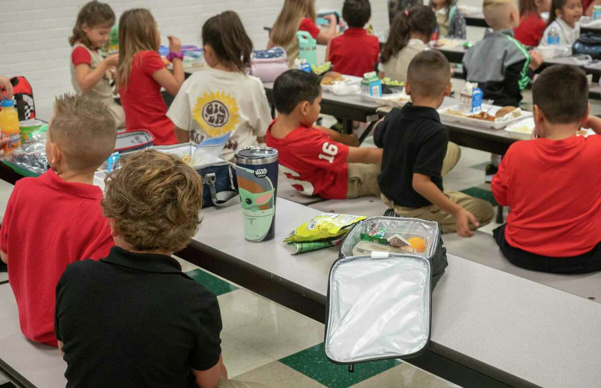 Cafeteria tables are filled for lunch 07/02/2021 at Bowie Fine Arts Academy during the first day of school for the 2021-2022 school year. Tim Fischer/Reporter-Telegram