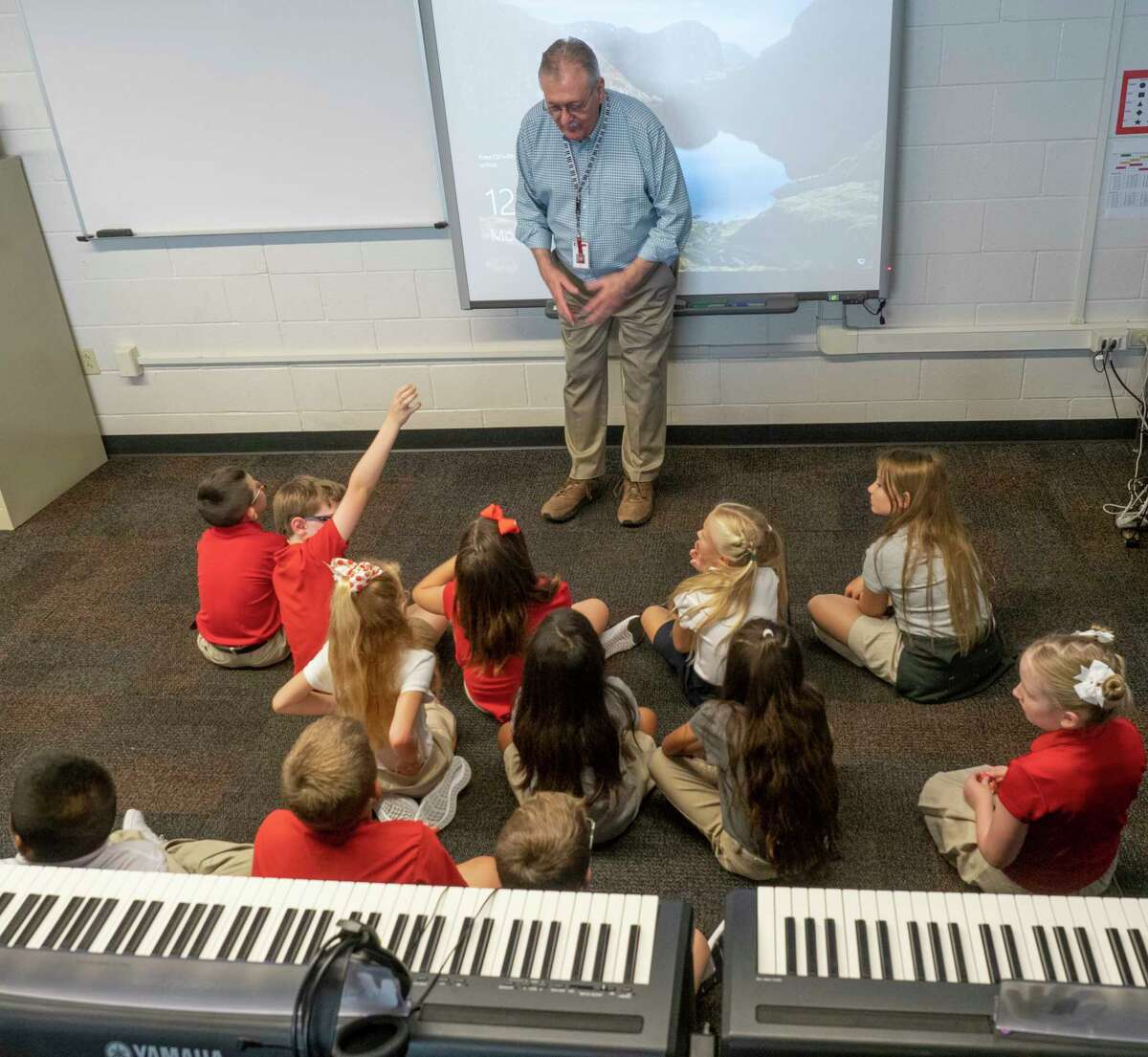 Piano instructor Randy Stevens talks with students 08/02/2021 at Bowie Fine Arts Academy during the first day of school for the 2021-2022 school year. Tim Fischer/Reporter-Telegram