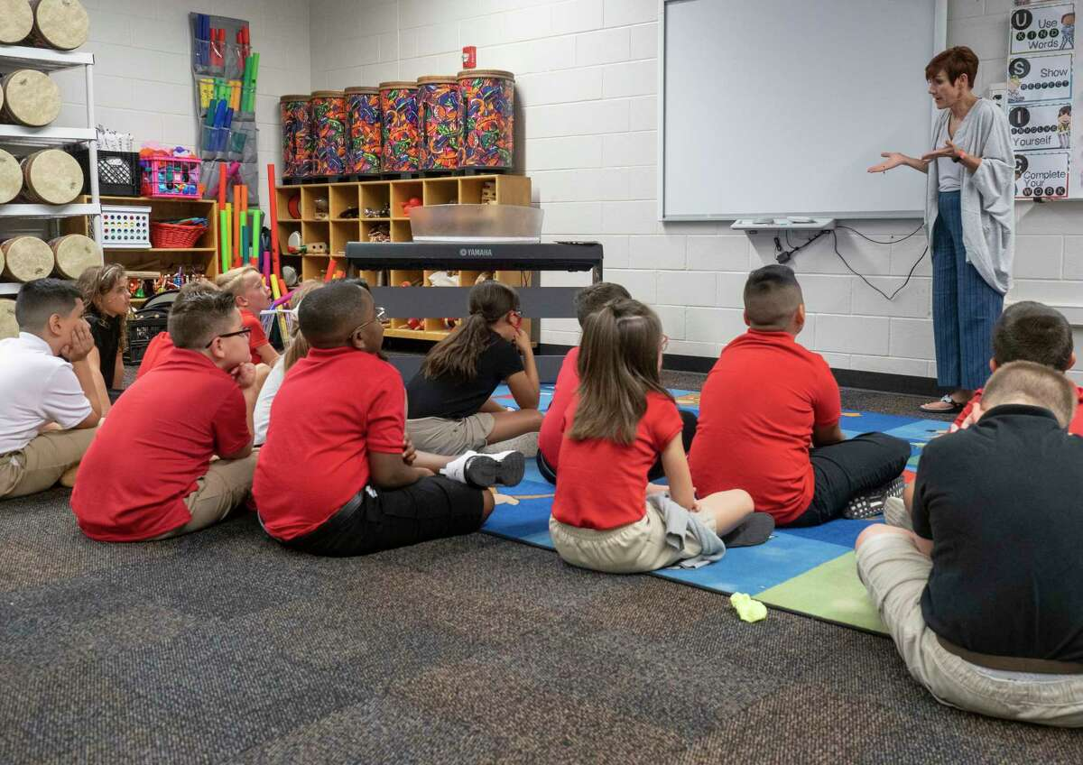 Children listen as their teacher goes over rules at Bowie Fine Arts Academy during the first day of school for the 2021-2022 school year. Tim Fischer/Reporter-Telegram