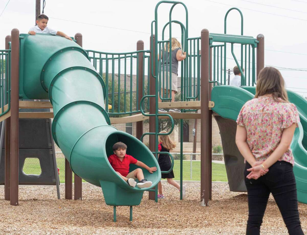 Children run and play during recess 07/02/2021 at Bowie Fine Arts Academy during the first day of school for the 2021-2022 school year. Tim Fischer/Reporter-Telegram