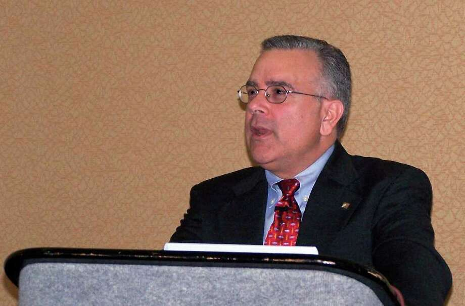 Allan Lamberti, founder of Billiken Group, speaking recently to an audience of Japanese executives at the InfoComm trade show in Las Vegas on the U.S. economy and its impact on U.S. sales efforts. Photo: Contributed Photo / Connecticut Post Contributed
