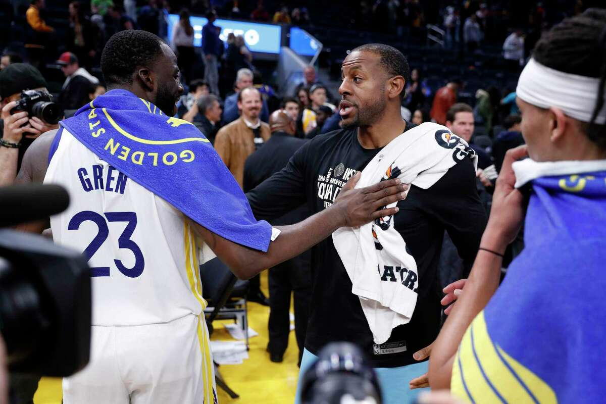 Golden State Warriors' Draymond Green and Miami Heat's Andre Iguodala after Heat's 113-101 win in NBA game at Chase Center in San Francisco, Calif., on Monday, February 10, 2020.