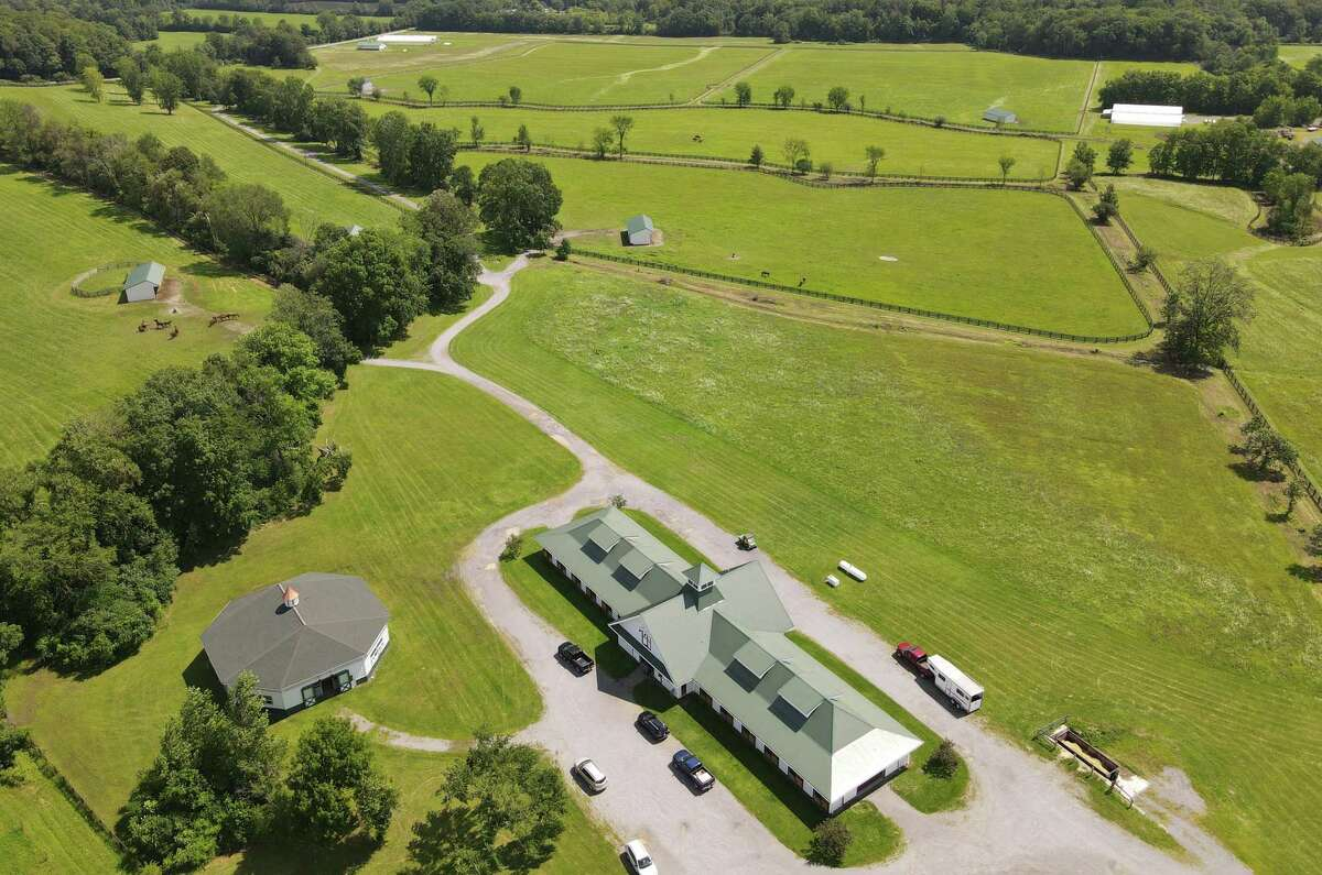 Aerial view of Stone Bridge Farm in Gansevoort showing the main horse barn.