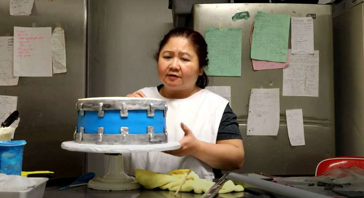Trang Tran decorating a cake to make it look like a drum on her YouTube channel Scratch to Table.