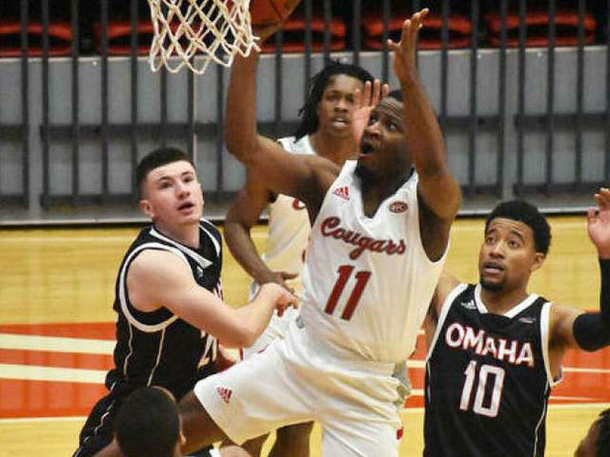 SIUE guard Courtney Carter goes up for a shot in traffic during a game against the University of Nebraska-Omaha inside First Community Arena in the Vadalabene Center.