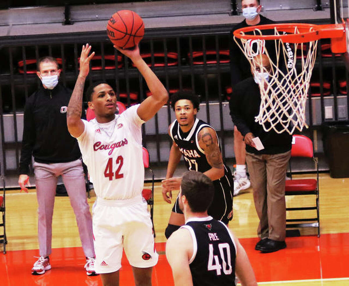SIUE's Lamar Wright (55) looks for a teammate in front of his twin Shamar Wright (left) during a game against Eastern Kentucky last season at First Community Arena in Edwardsville.